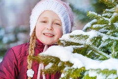 Portrait of smiling girl with green fir brush-wood Stock Image