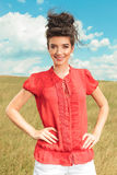 Portrait of smiling girl with hands on her waist Royalty Free Stock Image