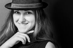 Portrait of a smiling girl in hat. Portrait of a smiling young beautiful girl in hat in retro style royalty free stock photography