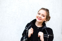 Portrait of smiling girl in high key against a white wall Stock Images