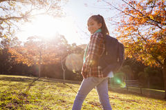 Portrait of smiling girl hiking at park Royalty Free Stock Image