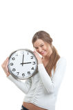 Portrait of a smiling girl holding clock Royalty Free Stock Image