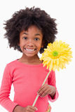 Portrait of a smiling girl holding a flower Stock Photo