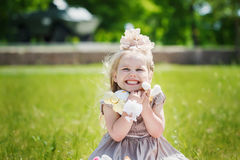 Portrait of smiling girl holding her favourite soft toy in summe Stock Photo