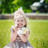 Portrait of smiling girl holding her favourite soft toy in summe Royalty Free Stock Photography