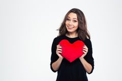 Portrait of a smiling girl holding red heart Royalty Free Stock Photos