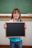 Portrait of a smiling girl holding a school slate Stock Images