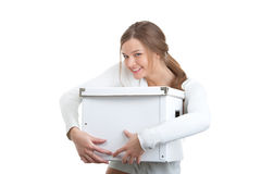 Portrait of a smiling girl holding white box Royalty Free Stock Photos
