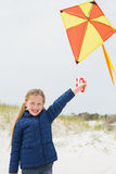 Portrait of a smiling girl with kite at beach Royalty Free Stock Photos