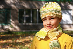 Portrait of a smiling girl. Smiling girl in a knitted cap in autumn park Stock Photography