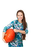 Portrait of smiling girl with a large red pumpkin Royalty Free Stock Photos