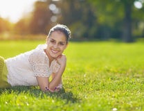 Portrait of smiling girl laying on meadow Royalty Free Stock Photography