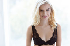 Portrait of a smiling girl in lingerie looking at camera Royalty Free Stock Photography