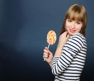 Portrait of smiling girl with a lollipop Stock Photo