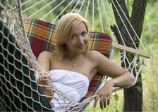 Portrait of a smiling girl lying in a hammock Royalty Free Stock Image