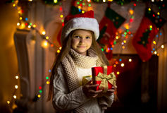 Portrait of smiling girl opening sparkling gift box at Christmas Royalty Free Stock Photos