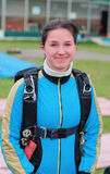 Portrait of the smiling girl-parachutist. In blue overalls Royalty Free Stock Photos
