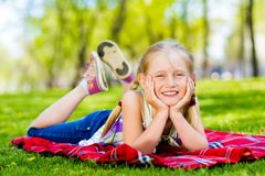 Portrait of a smiling girl in a park Stock Images