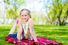 Portrait of a smiling girl in a park Stock Photo