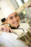 Portrait of smiling girl in pastry class Royalty Free Stock Photos