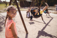 Portrait of smiling girl in playground Stock Images