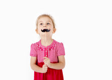 Portrait of smiling girl posing with mustaches on stick. Stock Photo