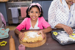Portrait of smiling girl preparing food in kitchen Stock Image