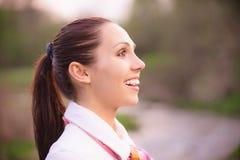 Portrait of smiling girl in profile Stock Photo