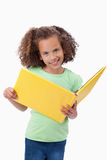 Portrait of a smiling girl reading a fairy tale Royalty Free Stock Photo