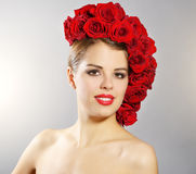 Portrait of smiling girl with red roses hairstyle Royalty Free Stock Photos