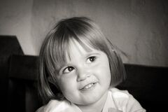 Portrait of Smiling Girl With Short Hair in Grayscale Photography Royalty Free Stock Images