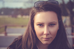 Portrait of smiling girl. With sunglasses on her head Royalty Free Stock Photos