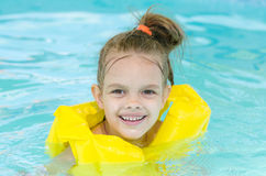Portrait of smiling girl in a swimming pool Stock Photos