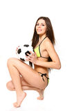 Portrait of a smiling girl in a swimsuit with a soccer ball on a Stock Images