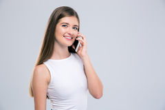 Portrait of a smiling girl talking on the phone Stock Photography