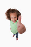 Portrait of a smiling girl with the thumb up Stock Photo