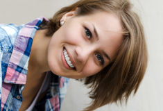 Portrait of a smiling girl. With tilted head Stock Photos