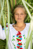 Portrait of smiling girl in ukrainian clothes at high grass Royalty Free Stock Photography