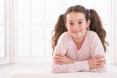 Portrait of smiling girl  she wears quilts with. Pretty teen girl with beautiful long hair smiling at camera. Studio shot Royalty Free Stock Photos