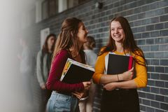 Female college students after lecture stock photo