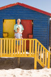 Portrait of smiling grandfather and boy standing at beach hut Royalty Free Stock Photography