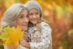 Smiling grandmother and granddaughter. Portrait of smiling grandmother and granddaughter  outdoors Royalty Free Stock Image