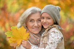 Smiling grandmother and granddaughter. Portrait of smiling grandmother and granddaughter  outdoors Royalty Free Stock Photos