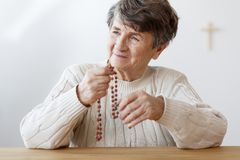 Smiling grandmother with rosary stock images