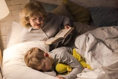 Grandma Reading to Little Boy Royalty Free Stock Image