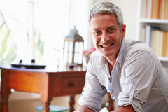 Portrait of�a smiling grey haired man Stock Images