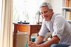 Portrait of�a smiling grey haired man sitting in a room. Portrait of�a smiling grey haired men sitting in a room Royalty Free Stock Photography