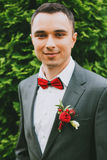 Portrait of smiling groom near bush Royalty Free Stock Images