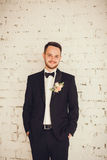 Portrait of a smiling groom in the room. Stock Image