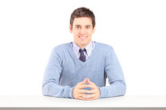 A portrait of smiling guy sitting during an interview Royalty Free Stock Image
